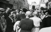 France, Chartres. Capra. August 18th, 1944. A mother (dark dress) and her daughter (white dress), accused of collaboration, have their hair shaved, as a sign of humiliation.