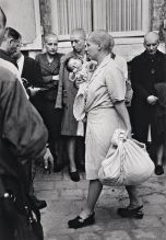 FRANCE. Chartres. August 18th, 1944. Just after the liberation of the town, a French woman who had had a baby with a German soldier, has her head shaved as a sign of humiliation.