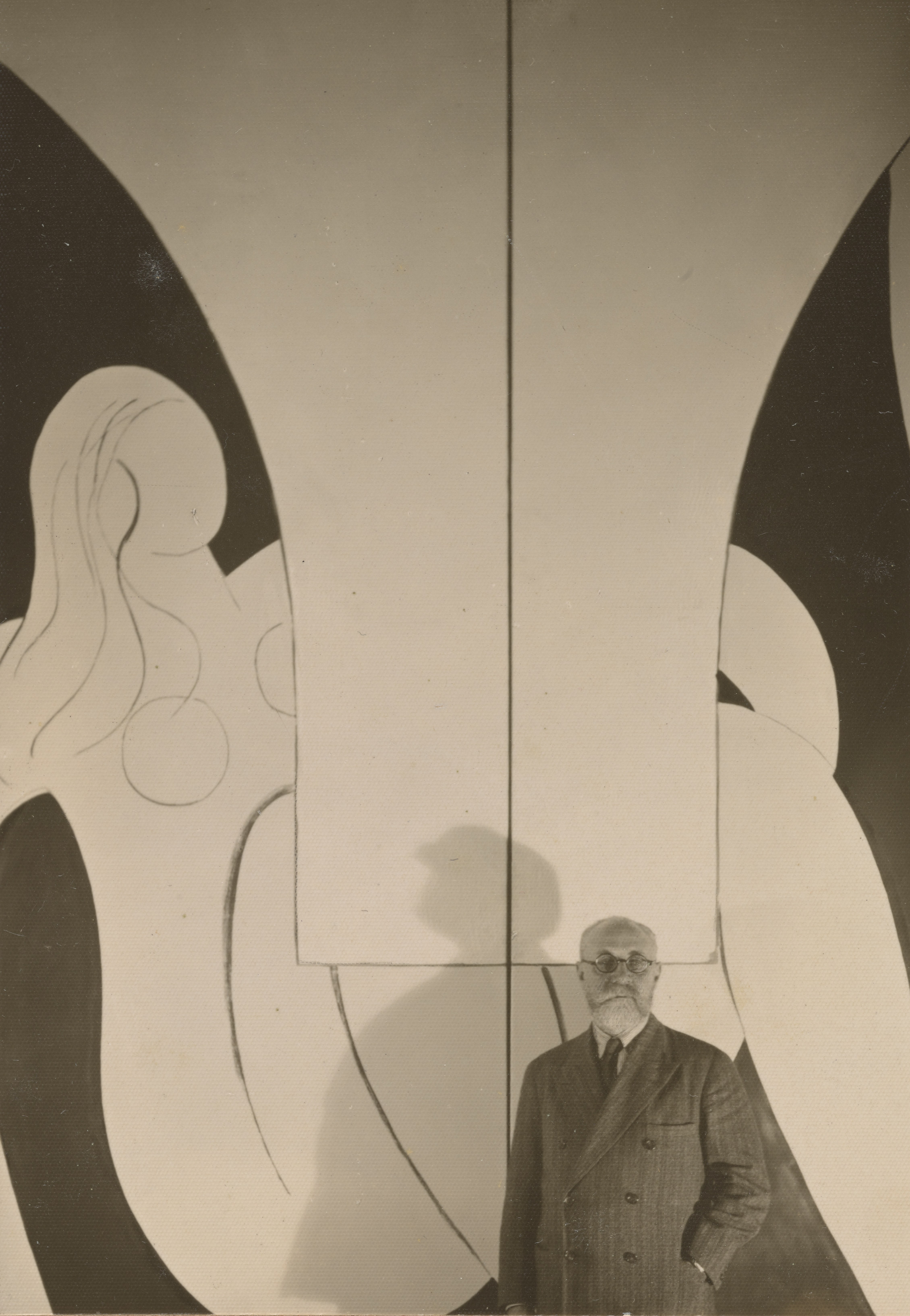Matisse with his painting The Dance (1932–33) in Nice, France, 1933.