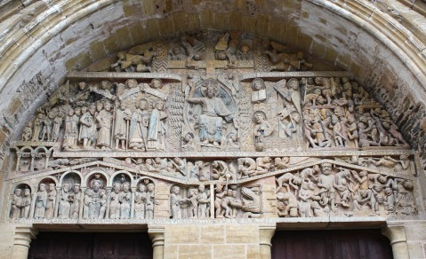 Detail of the Romanesque tympanum of the main portal of the Abbey Church of Saint Foy in Conques, Aveyron, France. Sec. XII