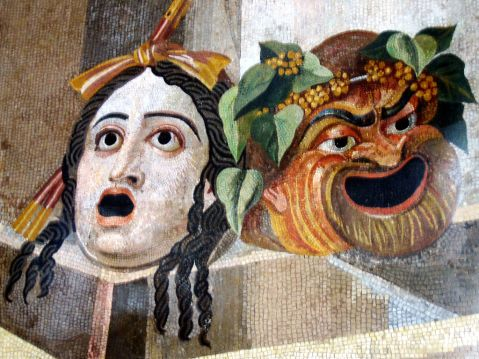 Mosaic showing theatrical masks of Tragedy and Comedy. Roman artwork, 2nd century CE.